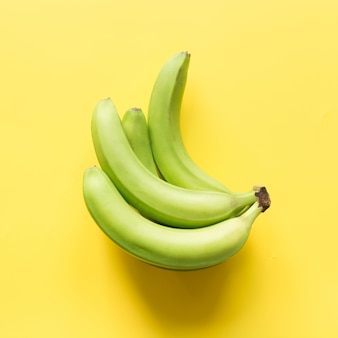 Sweet bananas on yellow,