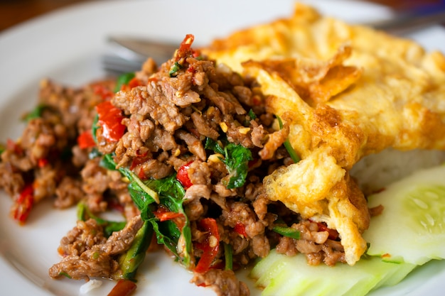 Sweet basil fried rice with minced pork, omelette