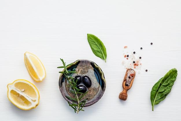 Sweet basil vinaigrette dressing ingredients on white wooden background .