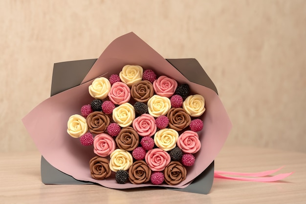 A sweet beautiful bouquet of chocolate roses lies on the table