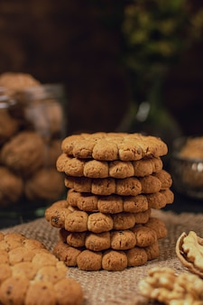 Sweet biscuits stack on burlap fabric