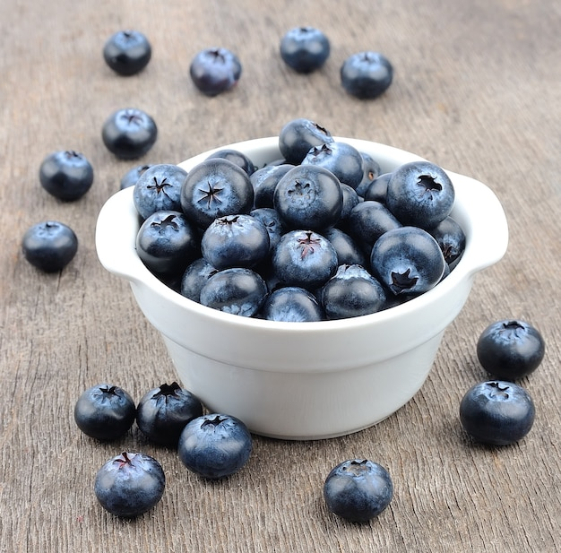 Sweet blueberries on wooden table.