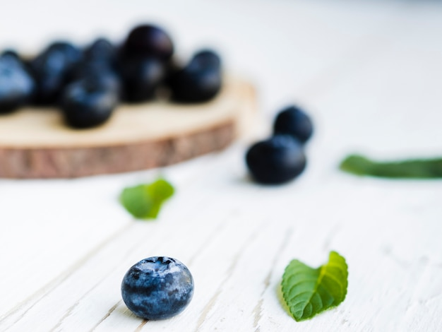 Sweet blueberry on wooden surface