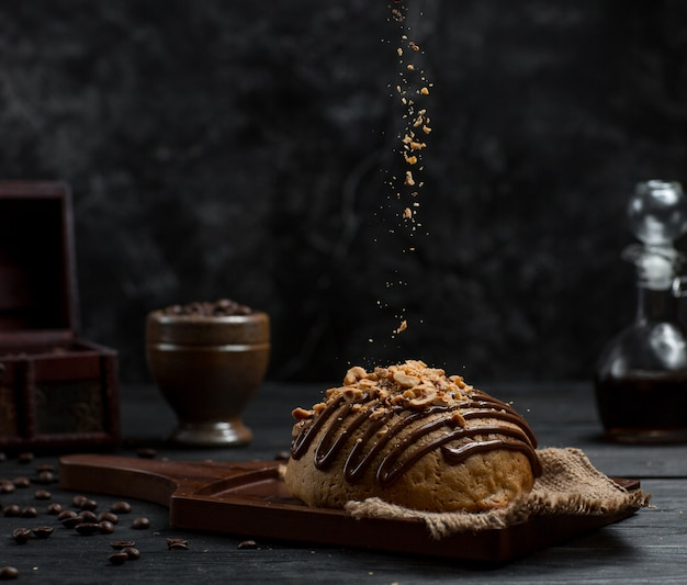 Sweet bun with chocolate syrup and peeled orange