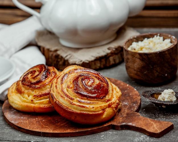 Sweet buns with sugar glaze