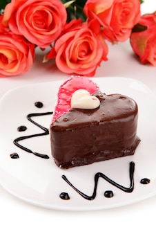 Sweet cake with chocolate on plate close-up