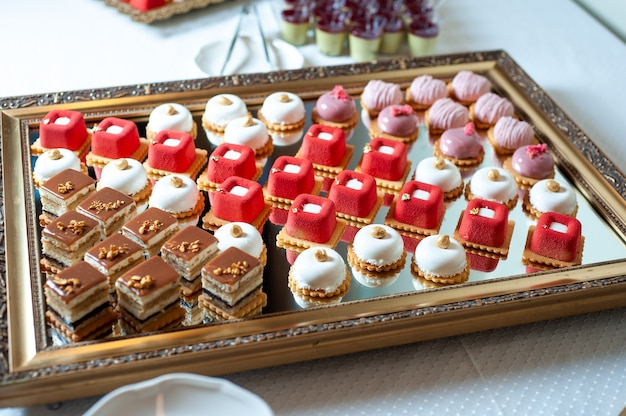 Sweet cakes at a wedding buffet catering