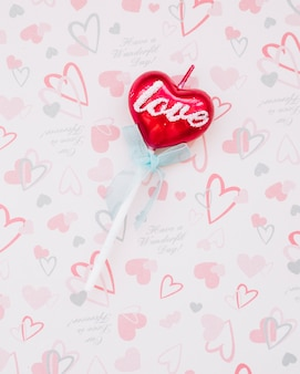 Sweet candy on wand in form of heart