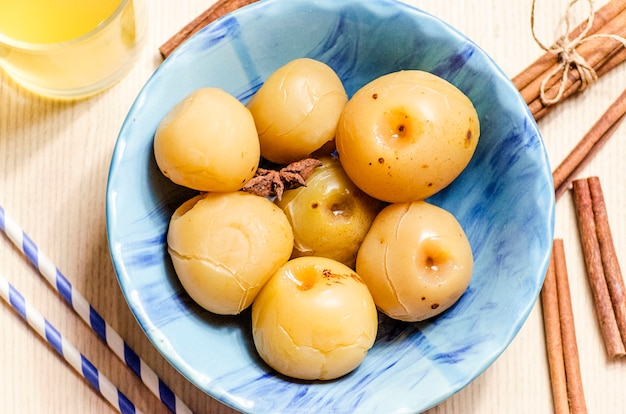 Sweet canned apples for the winter in a plate
