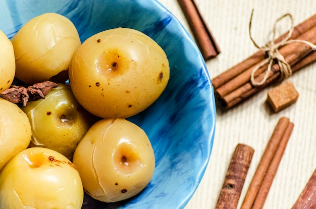 Sweet canned apples for winter in a plate