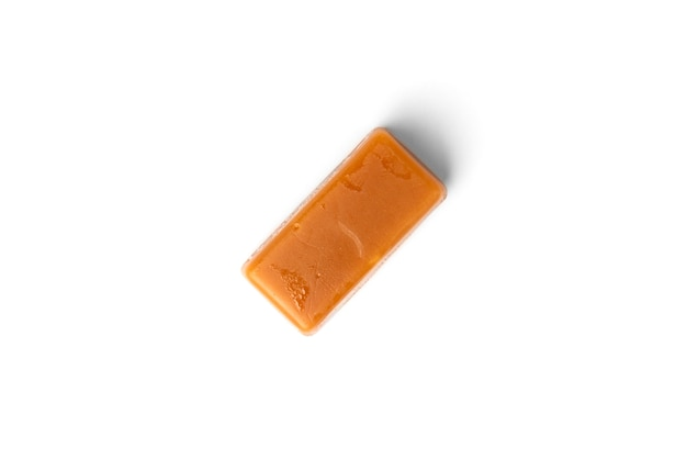 Sweet caramel bar isolated on a white background