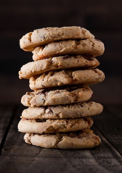 Sweet caramel oatmeeal gluten free cookies on old wooden background
