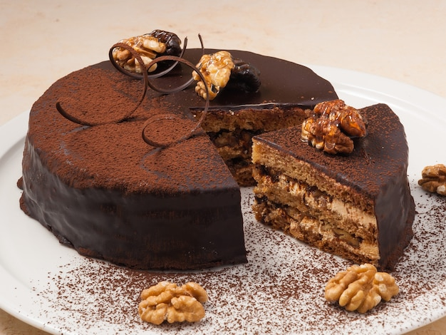 Sweet chocolate cake with cream and walnuts
