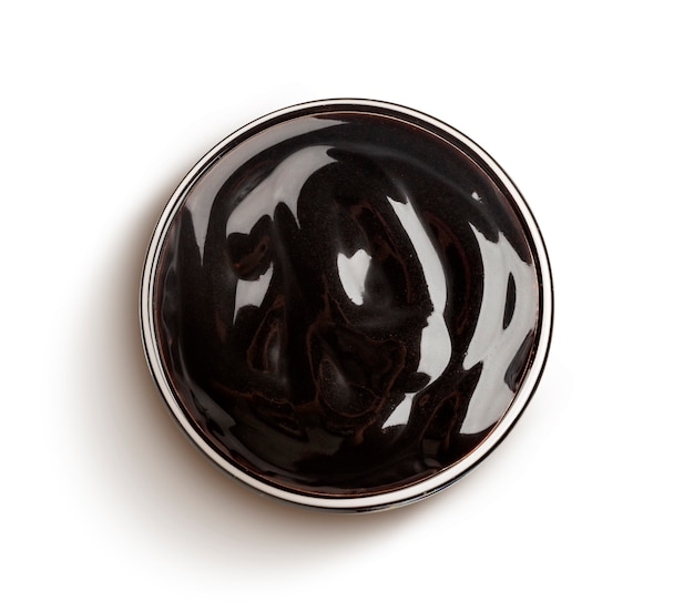 Sweet chocolate sauce isolated, top view