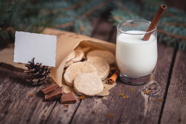 Sweet christmas cookies with milk on wooden desks