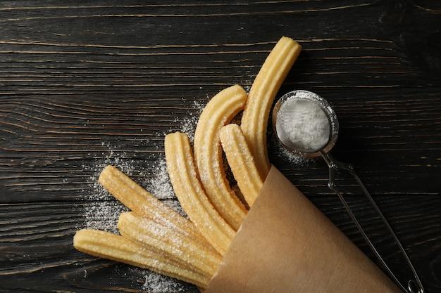 Sweet churros and powdered sugar