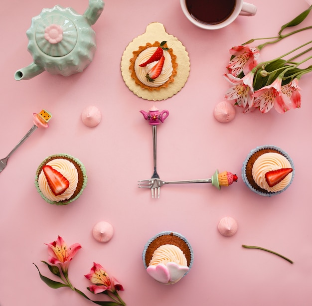 Sweet clock from cakes with strawberries