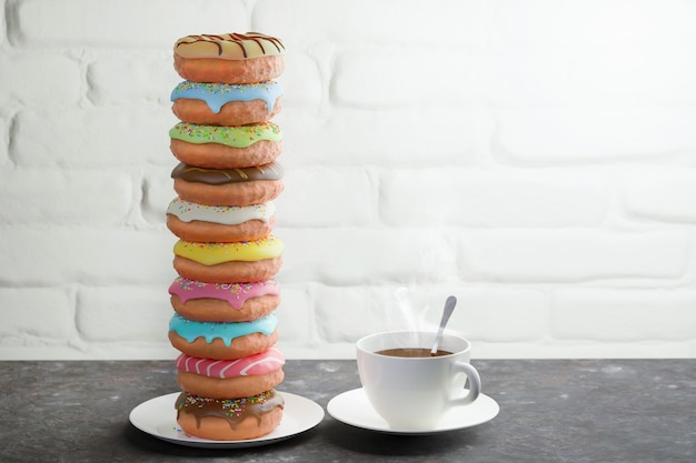 Sweet colored donuts and hot cup of coffee on a table near a white brick wall. breakfast concept.