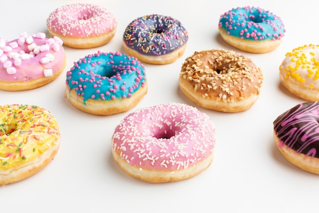 Sweet colorful donuts in close up