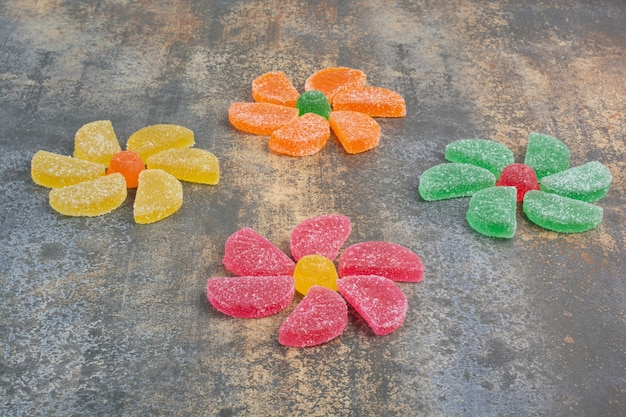 Sweet colorful jelly candy on marble background