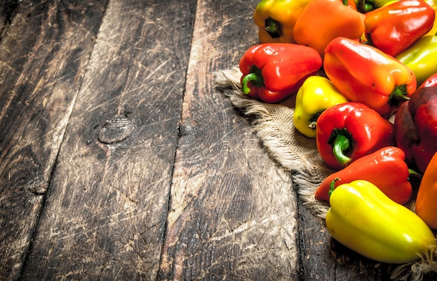 Sweet colorful pepper. on a wooden background.