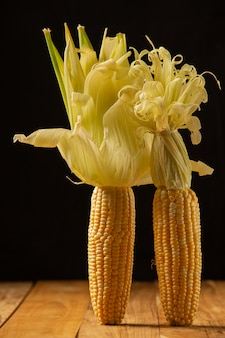 Sweet corn placed on a wooden floor.