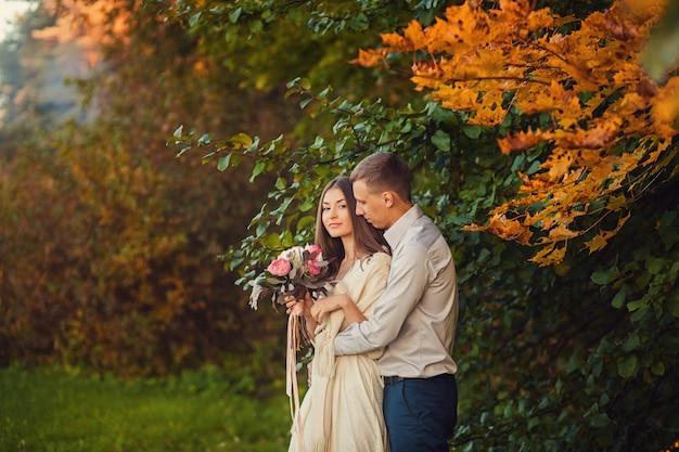 Sweet couple in autumn park