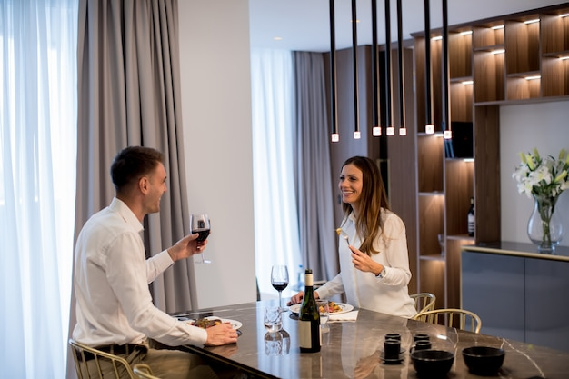 Sweet couple having a romantic dinner at luxury kitchen