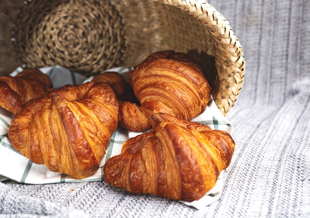 Sweet croissant, on a striped blanket, with copy space