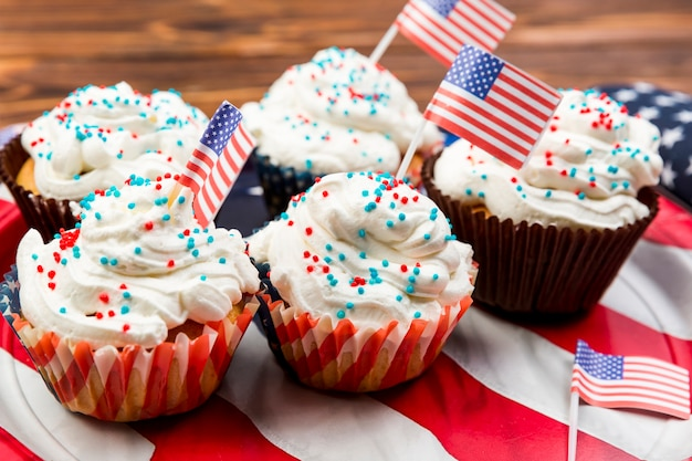 Sweet decorated cakes on american flag
