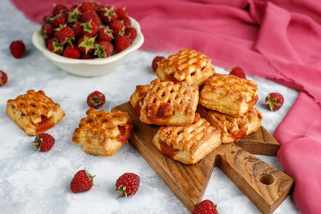 Sweet delicious raspberry cookies with ripe raspberries, top view