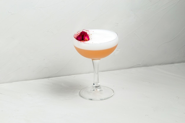 Sweet delicious sour foam cocktail with flower