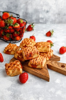 Sweet delicious strawberry cookies with ripe stawberries,top view