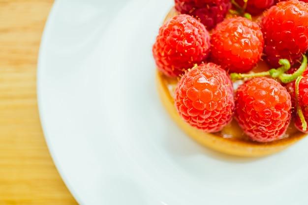 Sweet dessert custard tart with raspberry on top
