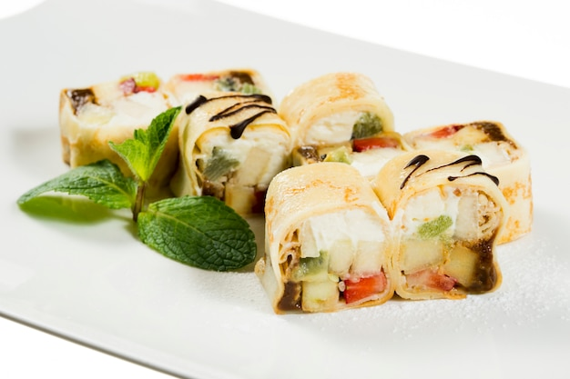 Sweet dessert wrapped in a roll of sushi rolls on plate
