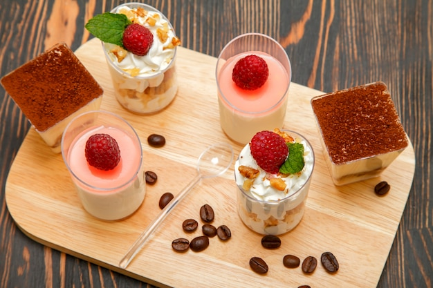 Sweet desserts on a wooden stand