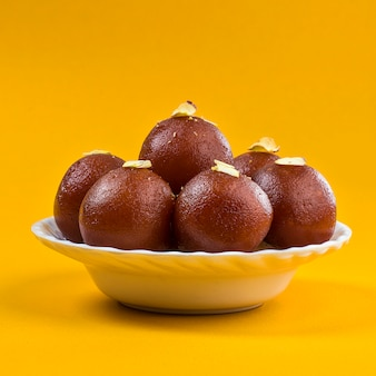 Sweet dish gulab jamun in a white bowl