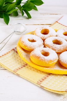 Sweet donuts with caster sugar