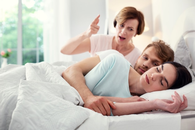 Sweet dreams. beautiful peaceful woman sleeping while being in the bed together with her husband