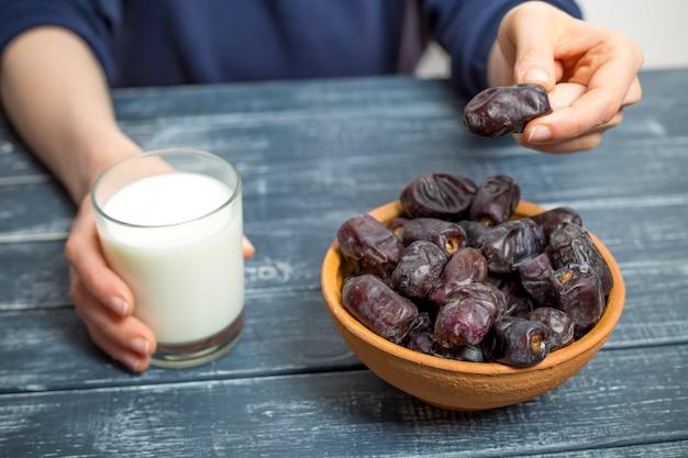 Sweet dry dates and milk. food during ramadan.