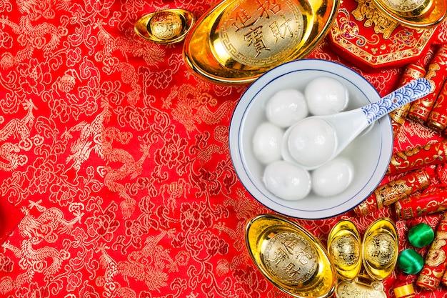 Sweet dumplings in bowl on table