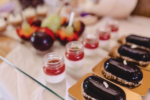 Sweet festive buffet, fruit, caps, macaroni and lots of sweets