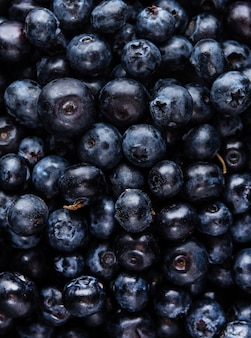 Sweet fresh blueberry macro pattern top view copy space texture blue color