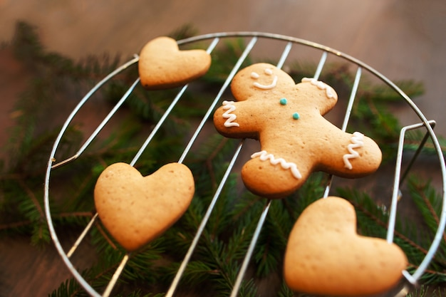 Sweet gingerbread hearts with man on grill