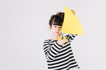 Sweet girl cutting paper