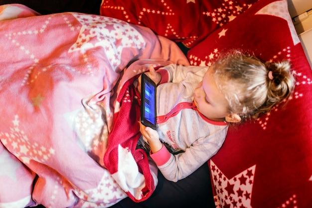 Sweet girl playing game on smartphone