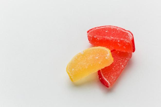 Sweet gummy fruit on whiter table