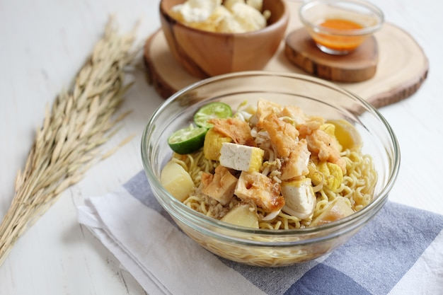 Sweet healthy noodles with tofu and potato on the bowl