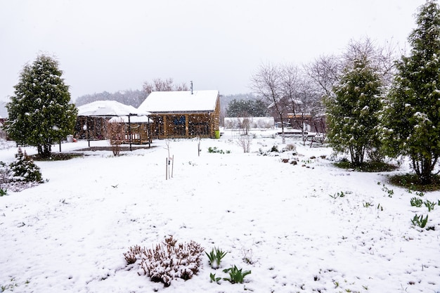 Sweet home in village on april snow