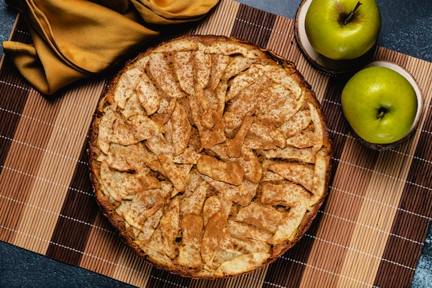 Sweet homemade apple cake with cinnamon. top view
